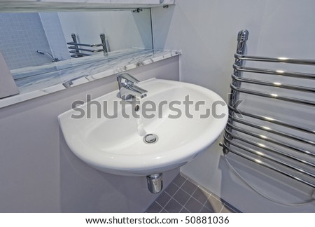 bathroom detail of a modern white ceramic hand wash basin - stock photo
