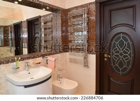 Bathroom interior fragment with a mirror niche - stock photo