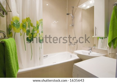 Bathroom interior with green accent - stock photo
