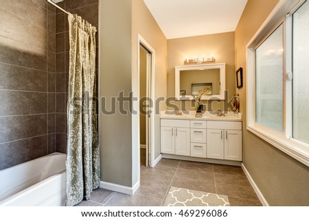 Bathroom interior with nice vanity and tile trim. Northwest, USA