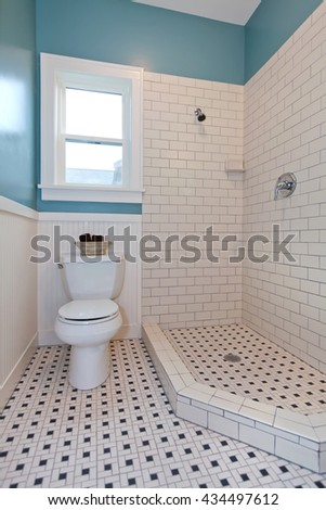 Bathroom interior with white tile and plank wall trim. - stock photo