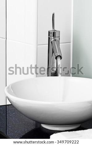 Bathroom modern contemporary stilish sink basin faucet tap ceramic water on   - stock photo