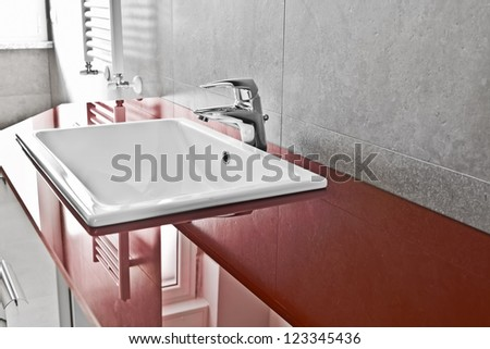 Bathroom red lavabo board with translucent surface - stock photo