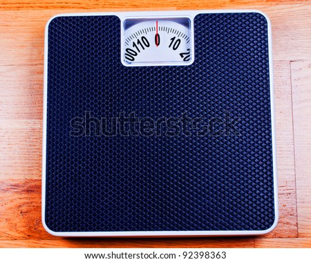 Bathroom Scale close up on plywood - stock photo