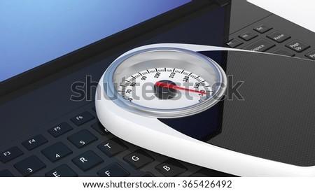 Bathroom scale on laptop keyboard - stock photo