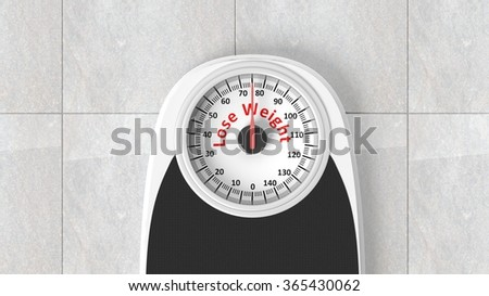 Bathroom scale with Lose Weight message on dial, on bathroom floor - stock photo