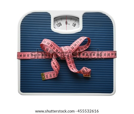 Bathroom scale with measuring tape on white background. Weight loss concept - stock photo