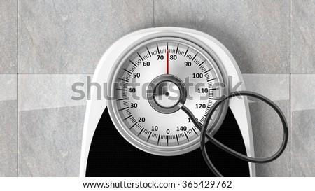 Bathroom scale with stethoscope, closeup on bathroom floor - stock photo