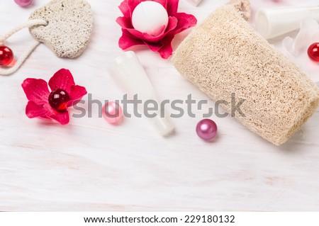 bathroom set with oil balls, bath flowers,sponge, pumice , spa background - stock photo