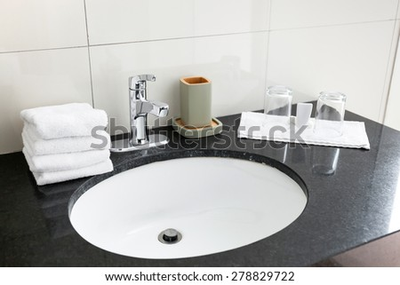 Bathroom sink at restroom resort interior  - stock photo