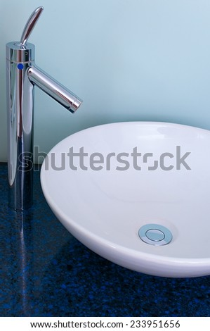 Bathroom sink bowl counter tap mixer - stock photo