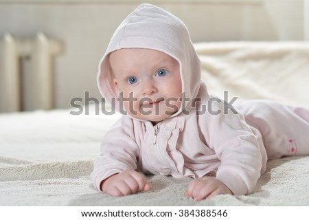 Bathroom textile for babies and children beautiful happy baby after bath look at the camera - stock photo