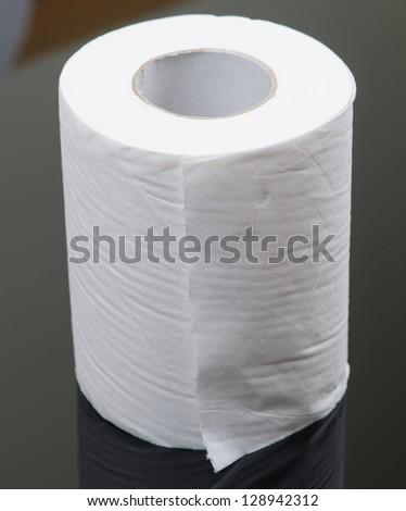 bathroom tissue isolated on black background - stock photo