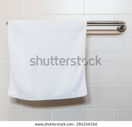 Bathroom Towel - white towel on a hanger prepared to use - stock photo