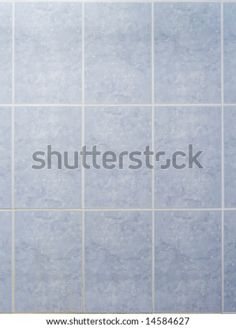 Bathroom wall with a blue ceramic tiles - stock photo