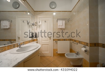 Bathroom with built-in appliances. Restroom. - stock photo