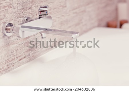 Bathroom with mixer. Nina Buday s  decor  set on Shutterstock