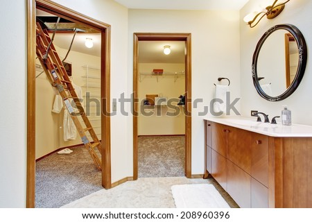 Bathroom with modern vanity cabinet and walk-in closets - stock photo