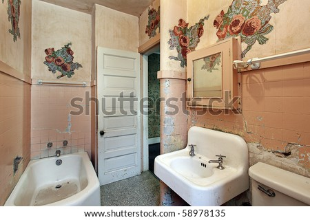 Bathroom with peeling paint in old abandoned home - stock photo