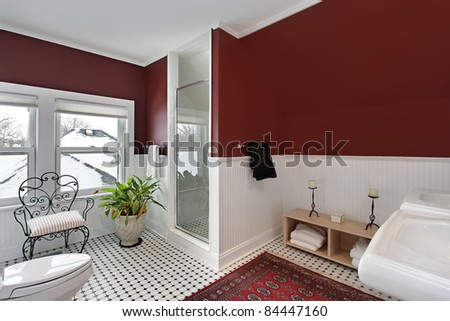 Bathroom with red walls and white siding - stock photo