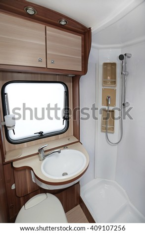 Bathroom With Shower and Toilet in Camper Van - stock photo