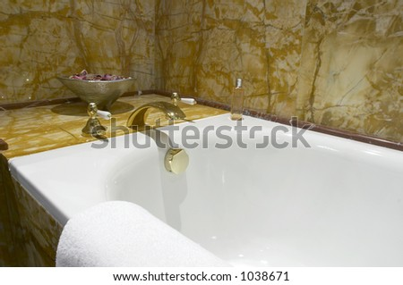 Bathtub faucet and towel - stock photo