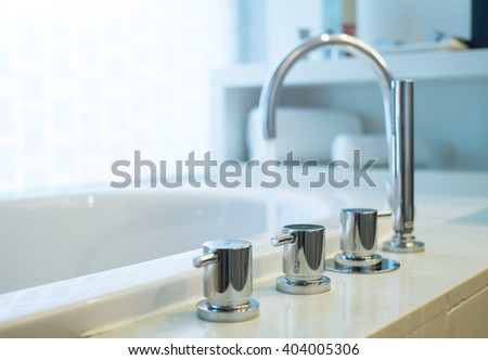 Bathtub faucet with running water,shallow focus. - stock photo