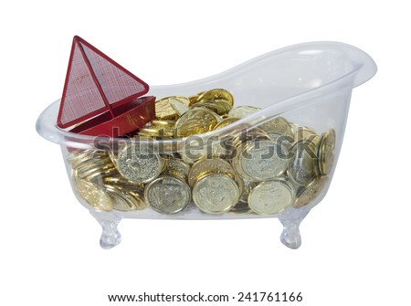 Bathtub filled with Gold Coins of riches and a red boat - path included - stock photo
