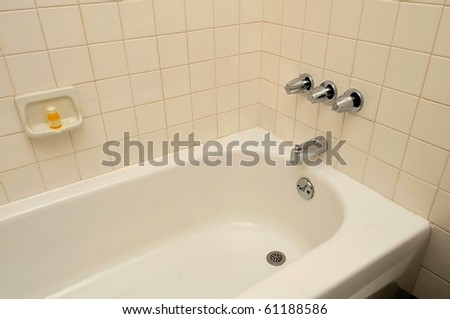 Bathtub in a luxurious hotel room. Suitable for concepts such as travel, tourism, vacation and holiday, spa, wellness and relaxation. - stock photo