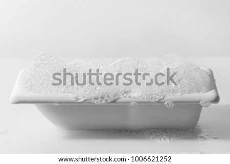 bathtub with foam isolated on a white background