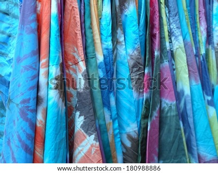 batic batik technique dyed silky cloths in fancy color and abstract pattern - stock photo