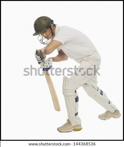 Batsman in forward defensive stance - stock photo