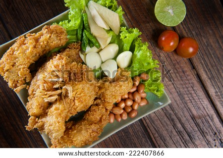 batter-fried fish fillet with vegetables - stock photo