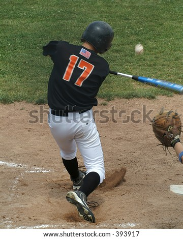 batter getting a hit - stock photo