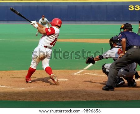 Batter hitting the baseball - stock photo