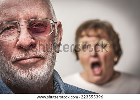 Battered and Scared Man with Screaming Angry Woman Behind. - stock photo