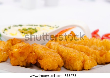 Battered chicken served with sauce - stock photo
