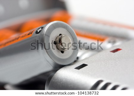 Batteries and chargers isolated on white background