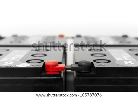batteries for uninterruptible power supply with black and red pole - stock photo