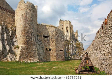 Battering-ram  in a dilapidated medieval citadel - stock photo