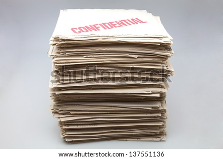battery of confidential documents on white fund - stock photo