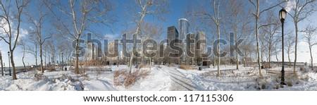 Battery Park under december's snow. - stock photo