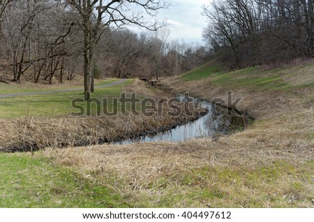 battle creek regional park scenic along trail and meandering stream flowing through forest  - stock photo