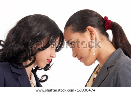 battle of two young female employees -  eye to eye - stock photo