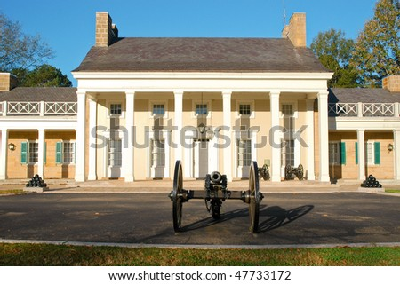 battlefield house and cannon - stock photo