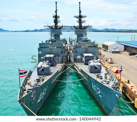 Battleship docked at the harbor. Bow with anchor and Thailand flag - stock photo