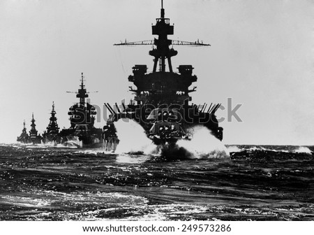 Battleship USS Pennsylvania is followed by three cruisers. They enter the Lingayen Gulf to support the U.S. Invasion of Luzon Island. Jan. 1945. Philippines, Pacific Ocean, World War 2. - stock photo