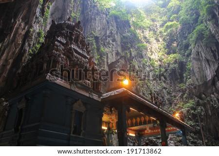 Batu Cave temple within cave within cave in Kuala Lumpur, Malaysia - stock photo
