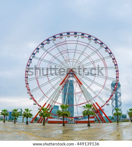 BATUMI, GEORGIA - MAY 24, 2016: The ferris wheel on the coastline is the favorite tourist attraction in the center of resort, on May 24 in Batumi.