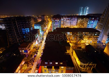 BATUMI, GEORGIA OCTOBER 3, 2017: Night streets of city with illumination. View from the roof of skyscraper.